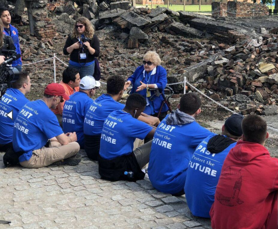 Eva Leading Group at Auschwitz